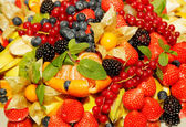 Assorted fresh fruit and berries — Stock Photo