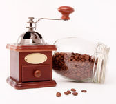 Wooden coffee grinder and coffee beans — Stock Photo