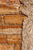 Old stone walls of city buildings, texture cement wall — Stock Photo