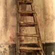 Shabby background with a ladder in the room with the old walls. — Stock Photo #18417673