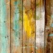 Background old wooden fence painted in different colors — Stock Photo