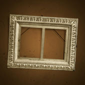 Vintage picture frame on old dirty wall — Stock Photo