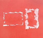 Růžové betonovou zeď s loupanými reklamy — Stock fotografie