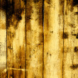 Gloomy background of the old wooden fence boards — Stock Photo