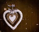 Decorative heart bauble hanging on the wall of the old — Stock Photo