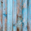 Rustic wooden fence purification of blue paint — Stock Photo