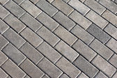 Grey tiles give a harmonic pattern at the ground — Stock Photo