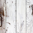 Grunge door painted with white paint with a rusty metal handle — Stock Photo