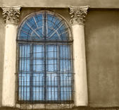 Old wooden windows with concrete walls and columns, sepia — Stockfoto