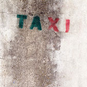 Old stencil taxi sign on the concrete wall — Stock Photo