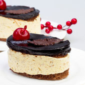 Dessert tiramisu with cream and chocolate, more beautiful cherry — Stock Photo