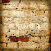 Yellow brickwork as a grunge wallpaper background — Stock Photo