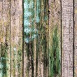 Old wooden planks painted with brown paint cracked by a rustic b — Stock Photo