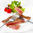Grilled beef steak with vegetables on white plate — Stock Photo