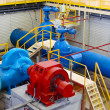 Industrial interior and pipes. Water pumping station. - Stock Photo