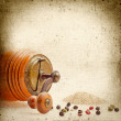 Old Pepper grinder mill with different dried peppers. Vintage pa — Stock Photo #26073079