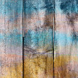 Abstract background old wooden fence painted in different bright — Stock Photo
