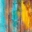 Old wooden fence painted in different colors  — Stock Photo