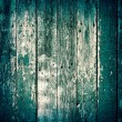 Old wooden boards painted with green paint cracks on rustic back — Stock Photo