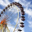 A colourful ferris wheel against a deep blue sky — Stock Photo