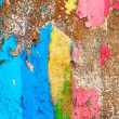 Stock Photo: Multi-colored paint on an old ragged wall