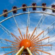 Stock Photo: Ferris wheel against a blue sky on a sunny day