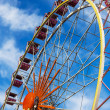Ferris wheel against a blue sky on a sunny day — Stock Photo #35257231