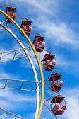 Ferris wheel against a blue sky on a sunny day — Stock Photo