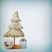 Christmas tree and baubles on background of the old textured fab — Foto Stock
