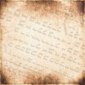 Of the ancient hieroglyphs on vintage textured fabric background — Stock Photo
