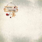 Christmas bauble on background of the old textured fabric — Stock Photo