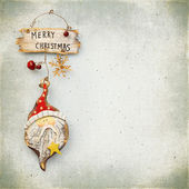 Christmas baubles on background of the old textured fabric — Stock Photo