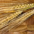 Wheat Ears on the Wooden Table. Sheaf of Wheat over Wood Backgro — Stock Photo