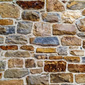Vintage textured background wall of natural stone — Stock Photo
