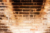 Background brick wall old furnace with charred bricks — Stock Photo