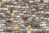 Wall built of natural stone — Stock Photo