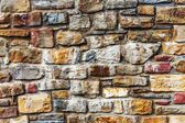 Wall built of natural stone — Stock Photo