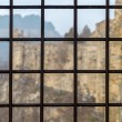 Foto Stock: Fortress seen through prison window with metal bars