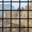 Stockfoto: Fortress seen through prison window with metal bars