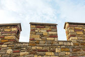 Old city fortification stone wall against blue sky - Upward view — Foto Stock