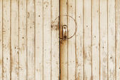Old wooden door with metal handle and lock — Stockfoto
