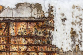 Background old cracked wall of a building with a metal armature — Stock Photo