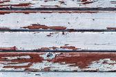 Pranchas de madeira velhas rachadas por um fundo rústico — Foto Stock