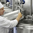 Worker on a milk factory — Stock Photo #40965129