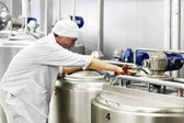 Worker on a milk factory — Stock Photo