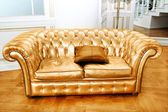 Beautiful vintage gold sofa next to wall (retro-style illustrati — Stock Photo