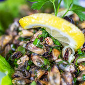 Creative serving fried mussels with herbs, selective focus  — Stockfoto