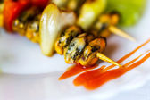 Steak of mussels on wooden skewers, selective focus  — Stock Photo