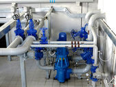 Water pumping station, industrial interior and pipes. Water syst — Stock Photo