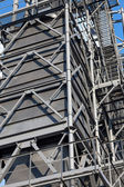 Metal hangar , storage tank silo of wheat and other cereals . — Stock Photo